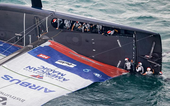 American Magic capsized during the America's Cup Challenger Selection Series in Auckland.