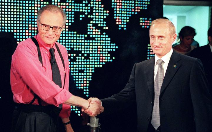 (FILES) In this file photo taken on September 07, 2000, Russian President Vladimir Putin (R) shakes hands with CNN interviewer Larry King before the start his interview in New York.