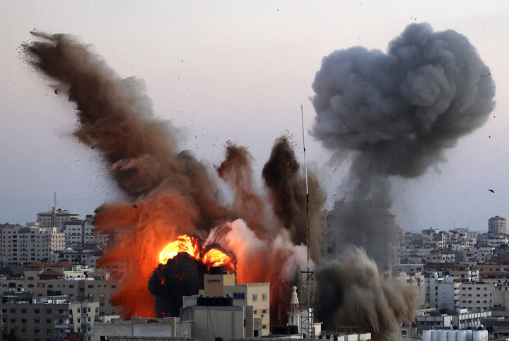 Smoke billows after an Israeli airstrike on Gaza City targeted the Ansar compound, linked to the Hamas movement, in the Gaza Strip on May 14, 2021.