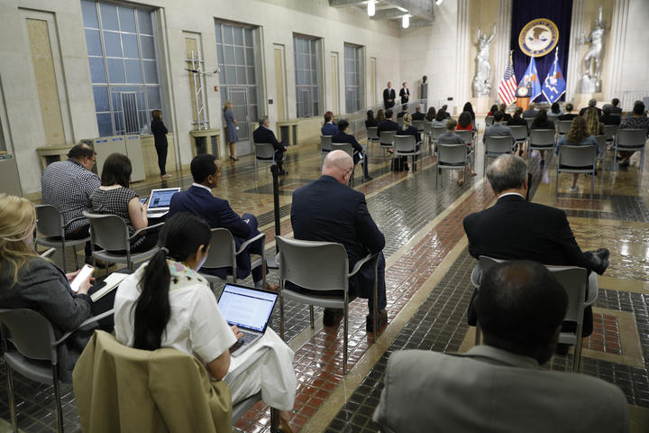 Journalists look on as US Attorney General Merrick Garland speaks at the US Department of Justice in Washington DC.