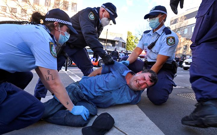 Police arrest a protester at a rally in Sydney