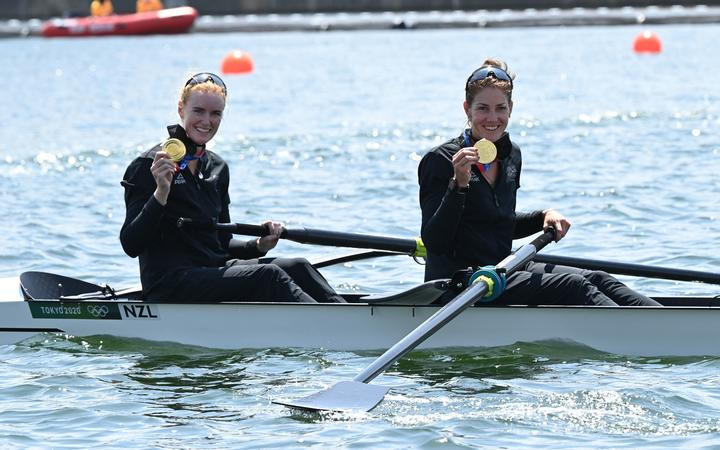 Gold medallists Grace Prendergast and Kerri Gowler pose in their boat following their women's pair final win.