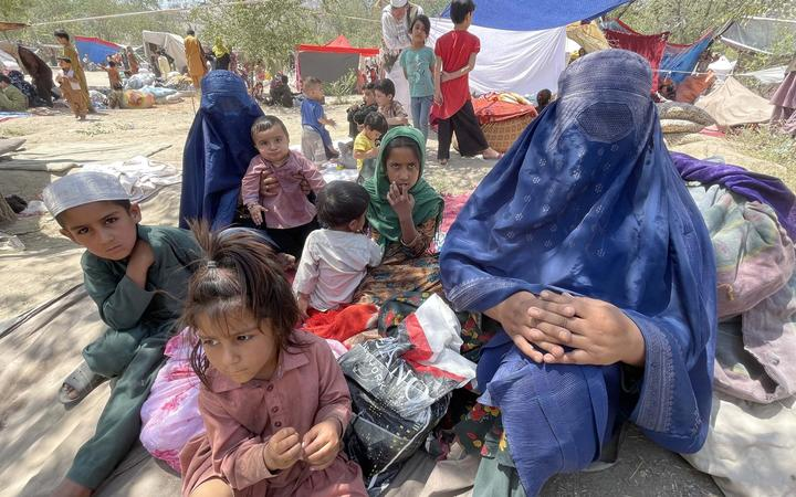 Displaced Afghan families flee northern provinces due to clashes between Taliban and Afghan security as they seek refuge inside a park with harsh conditions in Kabul, Afghanistan, on August 10, 2021.