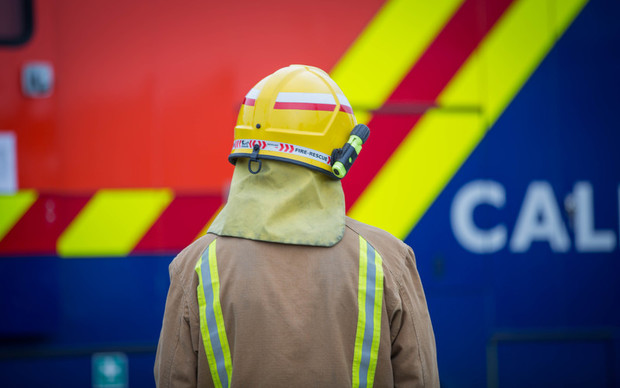 A firefighter on scene at an incident. 6 July 2016.