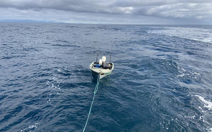 The dingy which made the trip across Cook Strait is towed to safety.