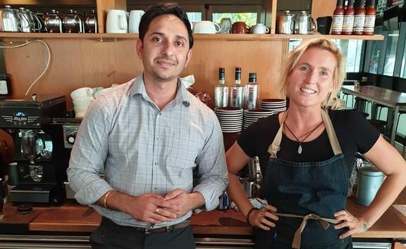 Piyush Katewa, who owns the Ministry of Food cafe, with Kim Black.