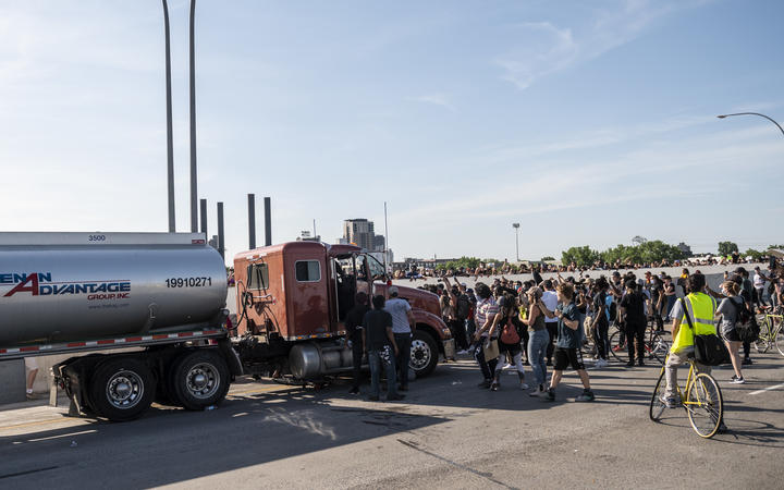 A large group of protesters had been marching over the bridge on both lanes before a truck drove into the crowd.