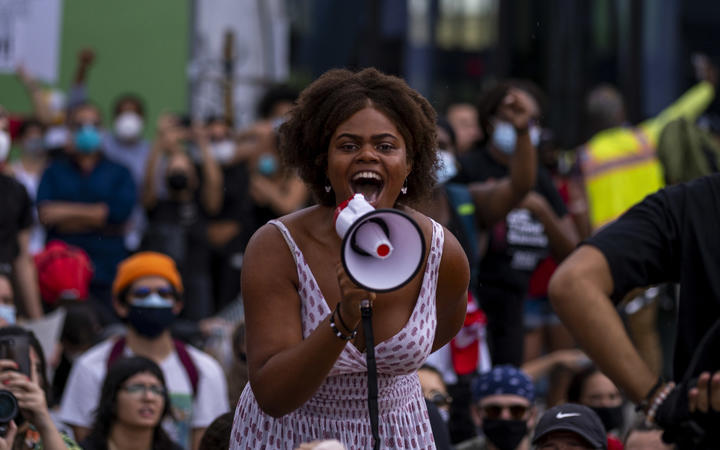 Protesters chant slogans during a rally in Miami, Florida
