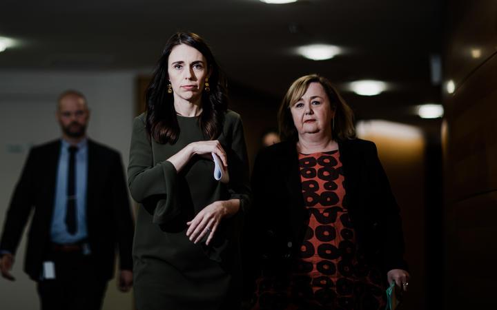 Prime Minister Jacinda Ardern and Housing Minister Megan Woods arrive at a post-Cabinet media briefing.  22/06/20