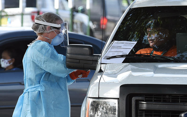 People are tested for Covid-19 at a drive through testing site sponsored by the city at Camping World Stadium on July 8, 2020 in Orlando, Florida.