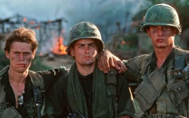 Actors Willhem Dafoe, Charlie Sheen and Tom Berenger during the filming of Oliver Stone's 1986 film Platoon
