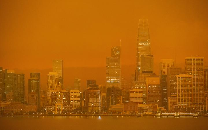 The San Francisco skyline is obscured in orange smoke and haze as their seen from Treasure Island in San Francisco, California on 9 September, 2020.