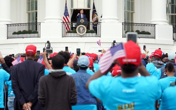US President Donald Trump speak about law and order to supporters from the South Portico of the White House in Washington, DC, on October 10, 2020. -