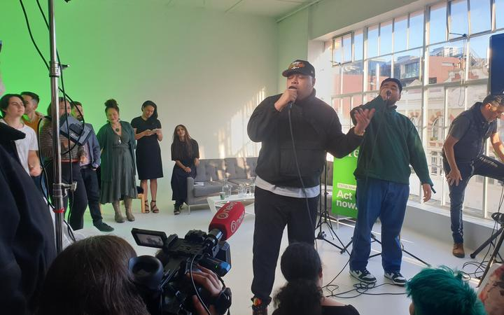 Church and AP perform at a Green Party rally in Auckland.