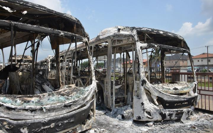 The aftermath of 23 BRT buses and a car set ablaze at Ojodu Berger terminal, along Lagos-Ibadan Expressway in Lagos on October 23, 2020.