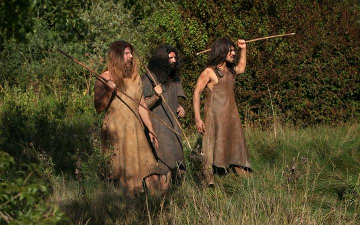 Scene of men hunting with spears in prehistoric times. Image taken from the filming of 'Paris la ville a remonter le temps' written by Carlo de Boutiny and Alain Zenou, directed by Xavier Lefebvre, a Gedeon Programmes production.
