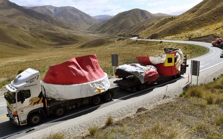 The truck convoy carrying the Auckland Farmers Santa passes the summit of the Lindis Pass on the way to Wanaka yesterday.
