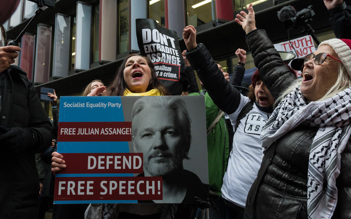 Supporters of Julian Assange cheer outside the Central Criminal Court (Old Bailey) after a judge ruled he should not be extradited to the United States on 4 January, 2021 in London, England.