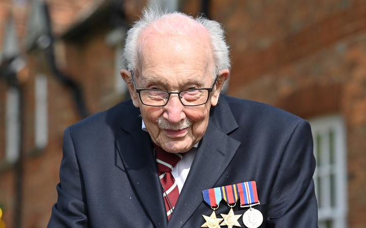 In this file photo taken in April 2020,  British World War II veteran Captain Sir Tom Moore is pictured during a lap of his garden in the village of Marston Moretaine, 50 miles north of London.