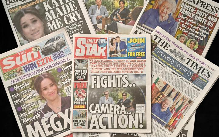 An arrangement of UK daily newspapers photographed as an illustration, shows front page headlines reporting on the story of the interview given by Meghan, Duchess of Sussex, wife of Britain's Prince Harry, Duke of Sussex, to Oprah Winfrey, which aired on US broadcaster CBS.