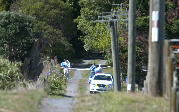 Photographs from outside the cordon at the crime scene in Kingseat.