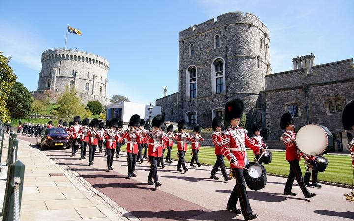 Members of the military march before the funeral service of Britain's Prince Philip, Duke of Edinburgh inside St George's Chapel in Windsor Castle in Windsor, west of London, on April 17, 2021.