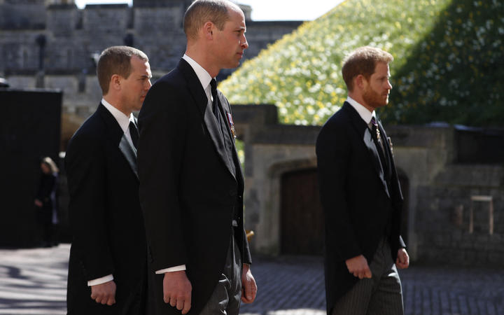Prince William, left, and Prince Harry walk in the procession behind the Duke of Edinburgh's coffin.