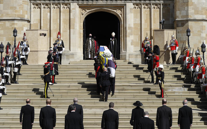 Pallbearers of the Royal Marines carrying the coffin up the West Steps into St George's Chapel.