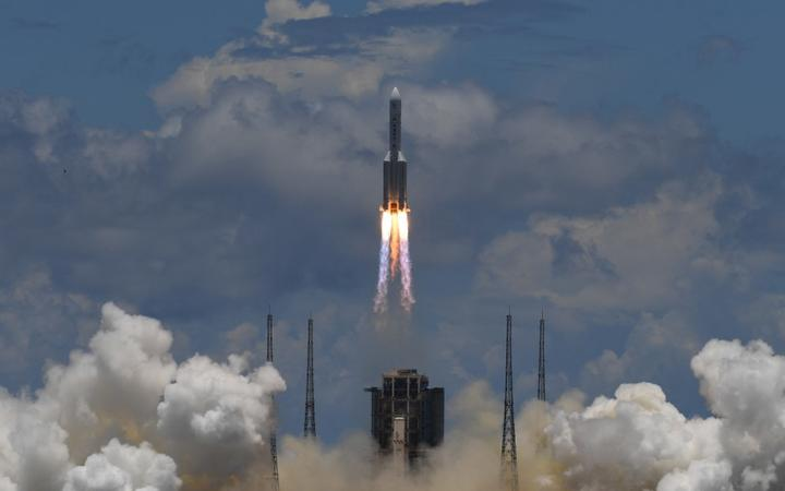 A Long March-5 rocket, carrying an orbiter, lander and rover as part of the Tianwen-1 mission to Mars, lifts off from the Wenchang Space Launch Centre in China's Hainan Province on July 23, 2020.