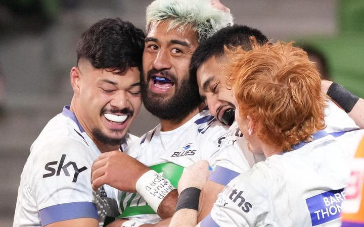 The Blues Akira Ioane, centre, after scoring a try in Round 1 of the Trans-Tasman Super Rugby against the Rebels at AAMI Park in Melbourne.