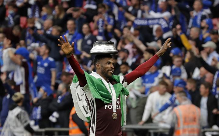 Leicester City's Nigerian striker Kelechi Iheanacho celebrates on the pitch as the Leicester players celebrate victory after the English FA Cup final football match between Chelsea and Leicester City at Wembley Stadium in north west London on May 15, 2021.