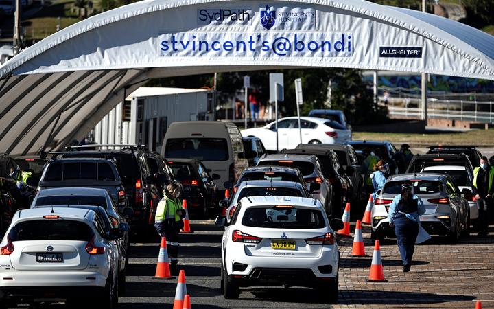 Health staff register residents at a Covid-19 coronavirus drive-through testing site on Bondi Beach in Sydney on 17 June 2021, after four positive cases.