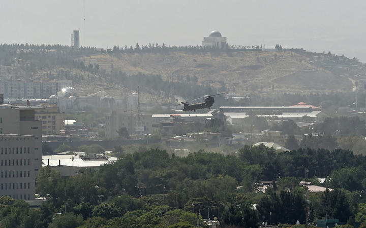A US military helicopter is pictured flying above the US embassy in Kabul on August 15.