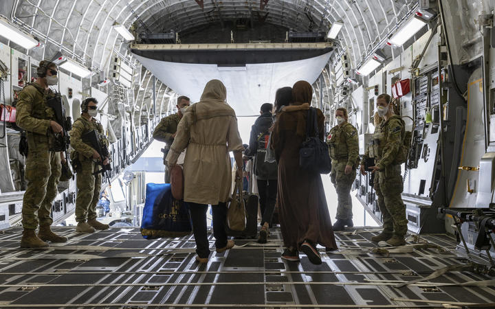 People disembark from an Australian Air Force plane after being evacuated from Afghanistan