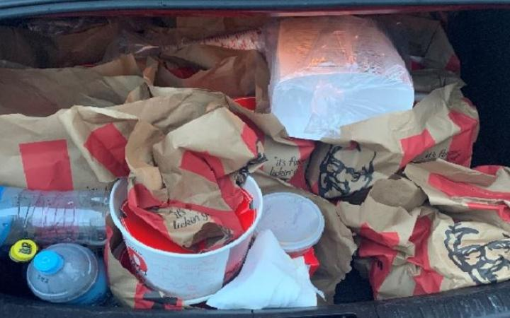 """There was more than $100,000 in cash and """"a car boot full"""" of KFC, police said."""