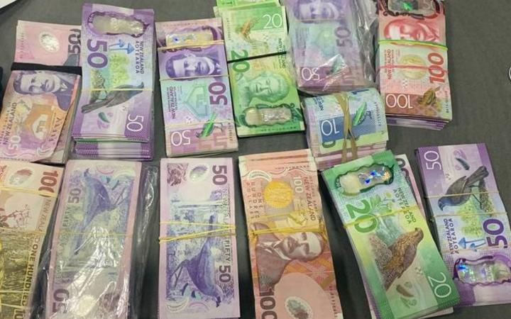 Police recovered more than $100,000 cash from the car.