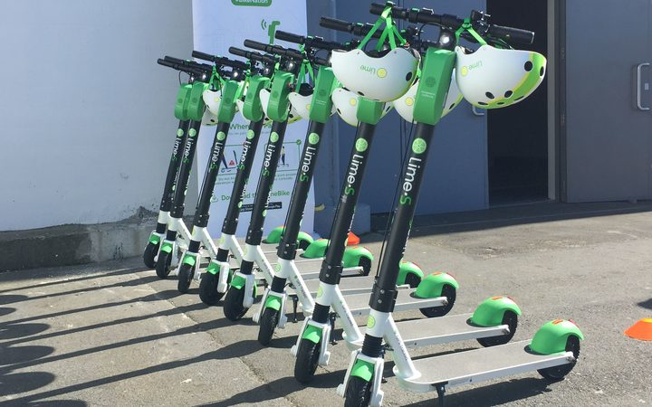 Rack 'em up: Lime scooters for hire outside the TraffiNZ conference in wellington this week - as part of a charm offensive in the capital.