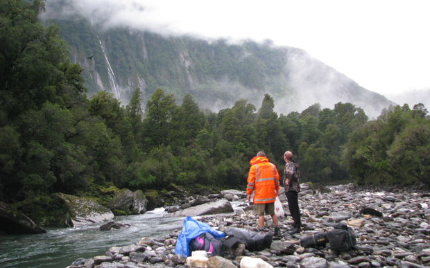 Members of a search party take stock after being dropped by helicopter into the Jacobs River area of the West Coast.