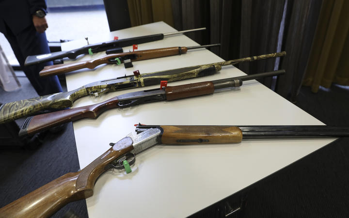 Firearms that will remain legal, depending on number of rounds and magazine type, on display at the police press conference.