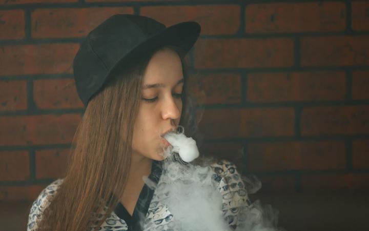 A teenager vapes.