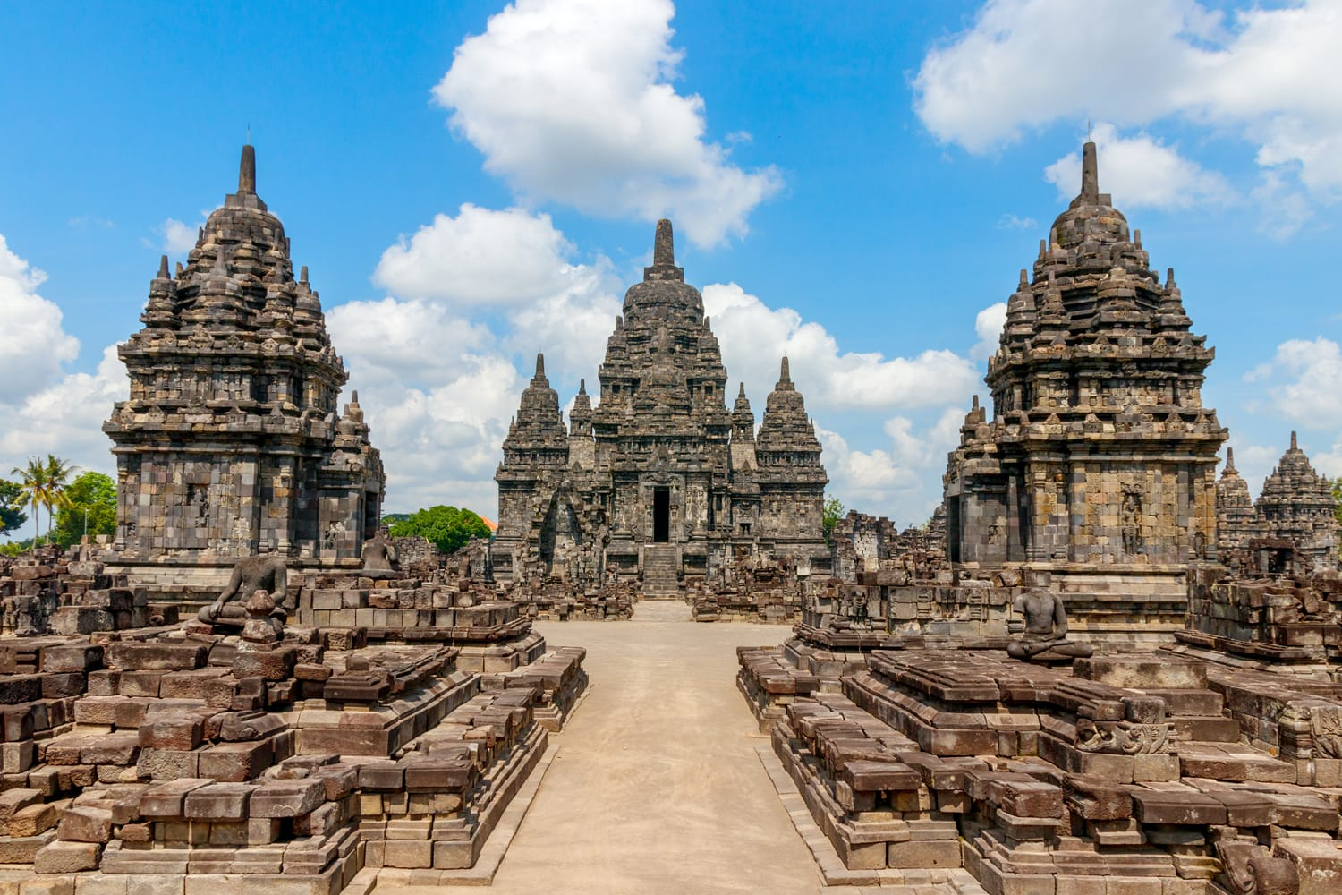 View of the Sewu temple complex under a blue sky with clouds. The Sewu temple is the second largest Buddhist temple of Indonesia and is located near the famous Prambanan temple.