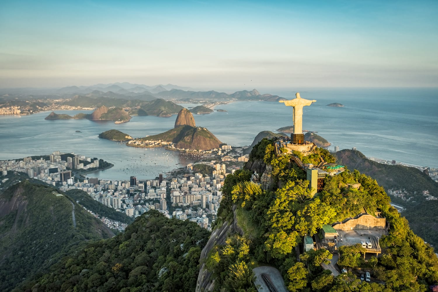 Aerial view of Christ The Reedemer Statue and Sugar Loaf Mountain from high angle. Rio de Janeiro in Brazil.