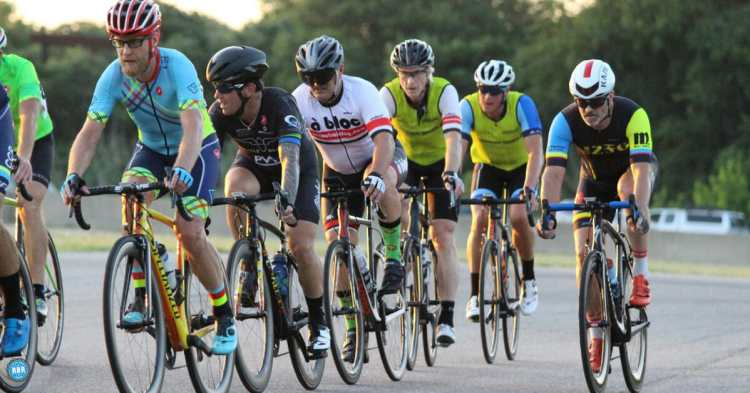 group of cyclists riding