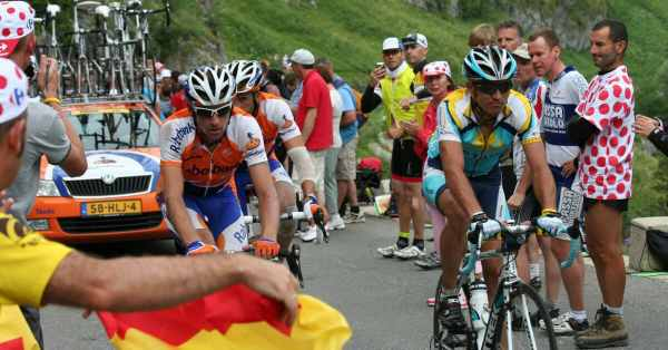 cyclists climbing at altitude