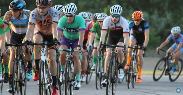 cyclists riding in a group on a fast ride