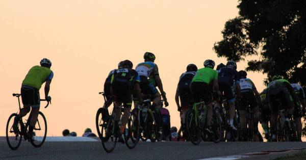 cyclists at dusk