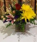 A burial bouquet honoring every family member, both dead and living.