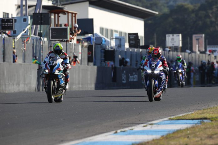 BMW Motorrad Motorsport's Xavi Fores leads F.C.C. TSR Honda France (5) early in the 12-Hours of Estoril. Photo courtesy BMW.