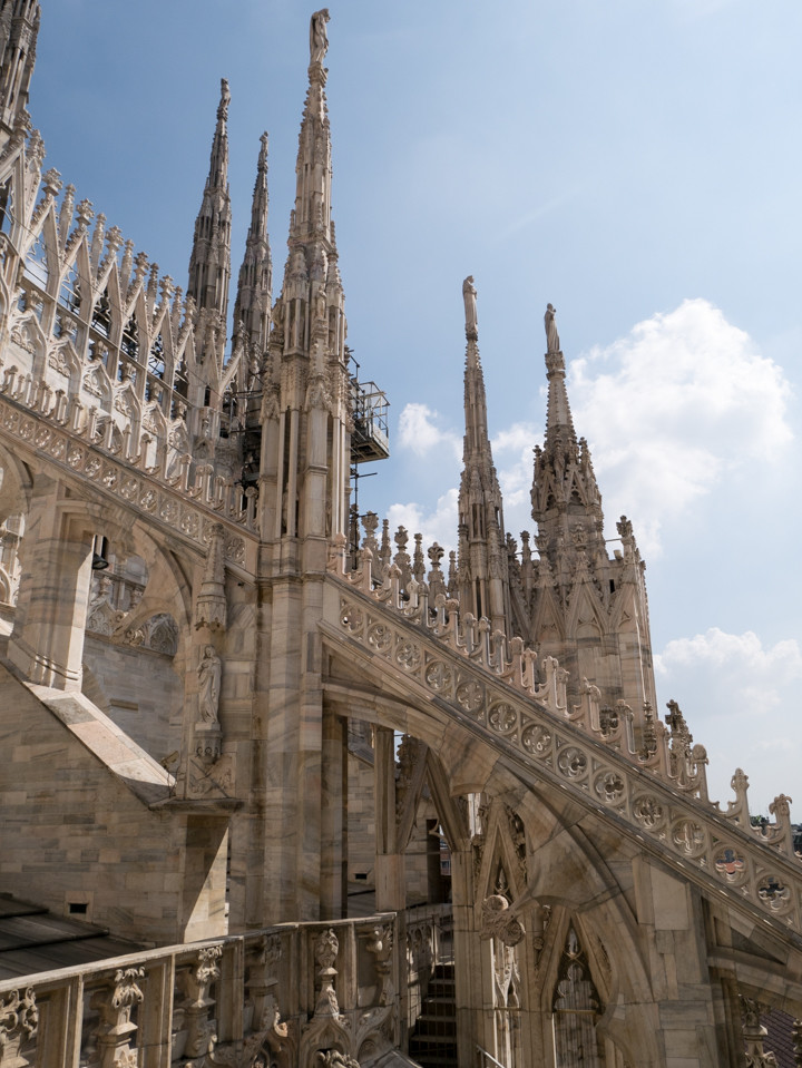 Pinnacles and spires set upon delicate flying buttresses on the roof of the Duomo di Milano - Milan Cathedral - Italy