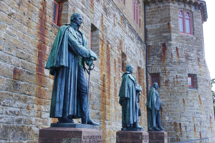 Bronze Statues of Prussian rulers at the Hohenzollern Castle in Germany - Check out roadtripsaroundtheworld.com to find out more